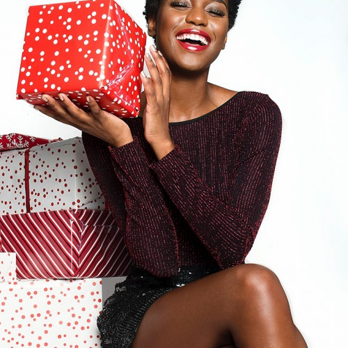 photo-of-smiling-woman-with-her-eyes-closed-sitting-on-gift-2552131