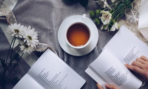 white-ceramic-teacup-with-saucer-near-two-books-above-gray-904616